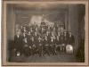 """1926    Concert in  Hotel \""""De Kroon \""""  bovenste rij v.l.n.r.:  Berend Sangers,......,Cees Westerveld, Jan Weenink Gzn.,Dries Thijssen, Karel van Schaik sr.                                                                                                         3e rij v.l.n.r.: Gerrit van Zon, Johan Aalders, Hendrik van de Velden, Albert Kl.Gotink, Cornelis van Schaik............, Karel van Schaik, Willem Pijpenbroek.                                                                                            2e rij v.l.n.r.: Gerrit Elissen, Berhard Lenting, Herman Luimes,Derk Hummelman, Bart van Zon sr. G.Th. Weenink, Evert van Zon, Lammert Bruntink, Johan Minkhorst, Gerrit Leenen.                                                                                              voorste rij v.l.n.r.: Jan Bruntink, Derk Pijpenbroek, Hendrik Hummelman, dirigent G.J.Struik, Bertus Luimes, Bart van Zon, Jan Leenen."""