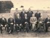 1914-1939    25 jarig Jubileum  staand v.l.n.r.: Derk Hummelman, Bertus Luimes, Hendrik Hummelman, Jan Leenen. zittend v.l.n.r.: Henk Sierdsma, Evert van Zon, dirigent Leo Dekker, Hendrik Brouwer, Jan Bruntink, Herman Luimes, Cees Westerveld